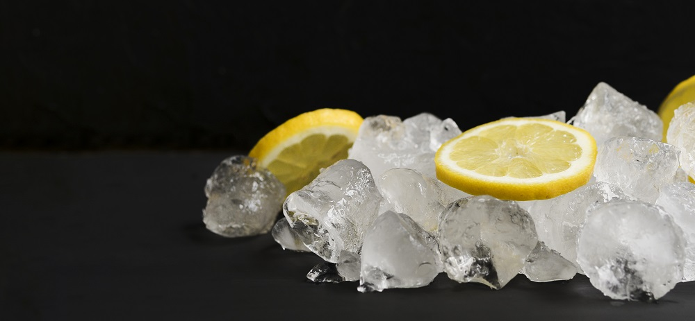 Ice Cubes with Lemon Slices Laying Over Top of Them