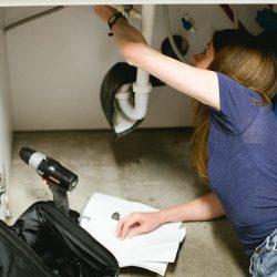 Plumber Repairing a Kitchen Sink